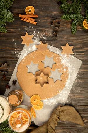 Baking ingredients - flour, rolling pin, gingerbread, candied fruit, cinnamon.