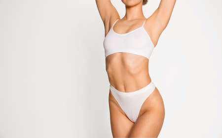 Beautiful female body in underwear over white background. Beauty fitness concept