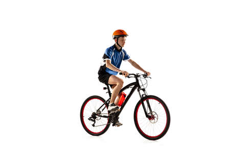 Young Caucasian boy bike rider with road bike isolated over white background. Stockfoto