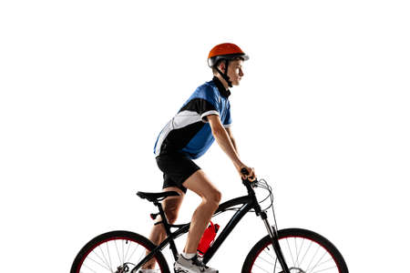 Young Caucasian boy bike rider with road bike isolated over white background. Imagens