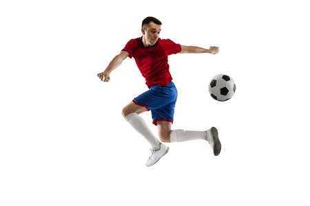 Young Caucasian soccer football player training isolated on white background.
