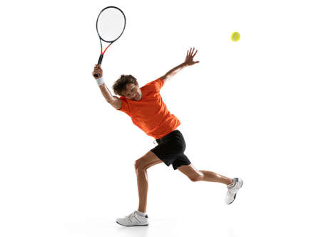 Young Caucasian man, tennis player posing isolated on white background.