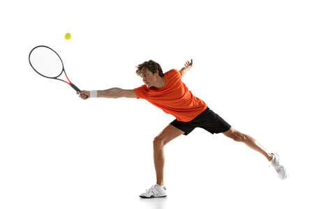 Young Caucasian man, tennis player posing isolated on white background. Zdjęcie Seryjne