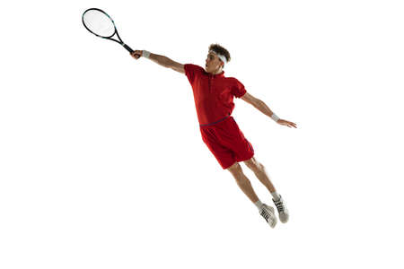 Portarit of Caucasian man, professional tennis player isolated on white background.