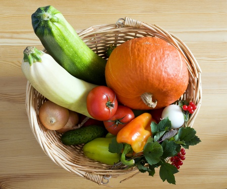 produces: Fresh vegetables in a wicker basket Stock Photo