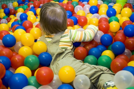 pool balls: Baby girl in ball pit