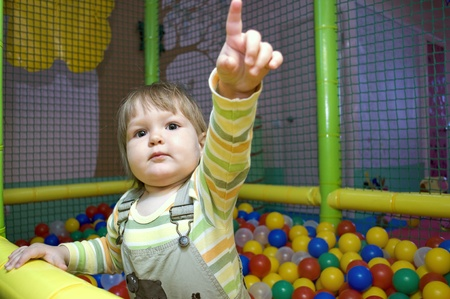 Baby girl in ball pit photo