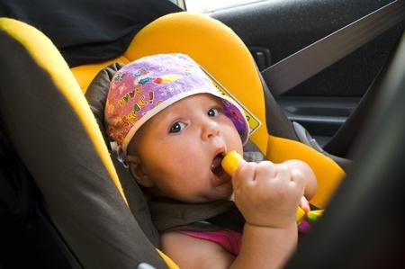 Baby in car seat  Foto de archivo