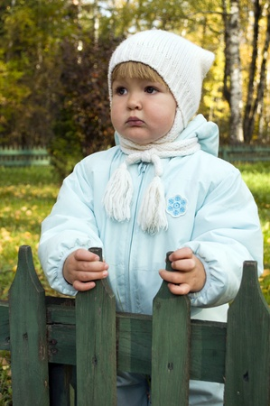 A child stands outside the fence Stock Photo - 11013342