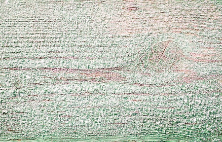 Background of a wooden bench, covered with frost photo