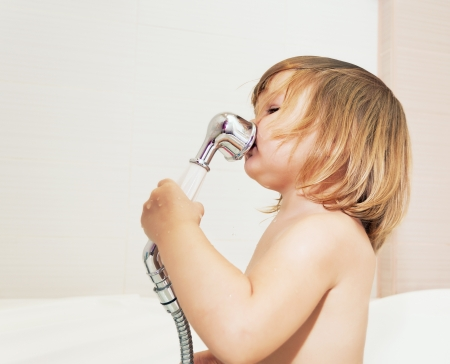 bathing beauty: Baby, singing in the shower