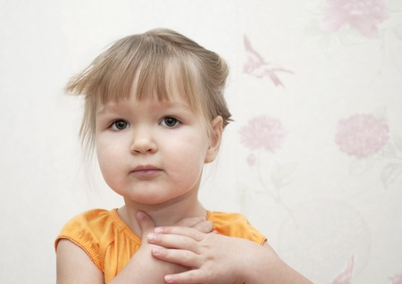 Portrait of little girl with hands near her face