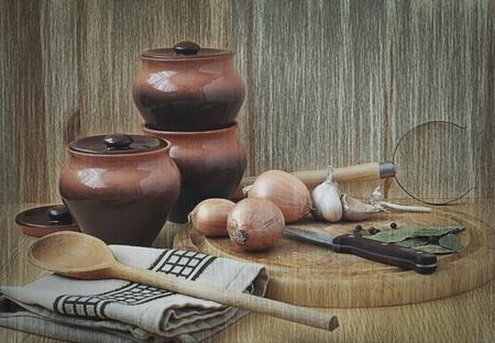 kitchen still life with pots, garlic and allspice  photo