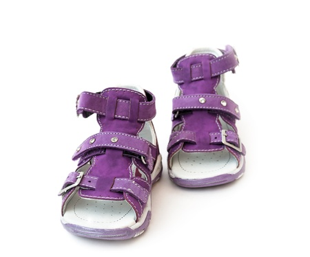 Lilac baby sandals on a white background