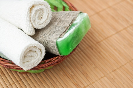 Spa setting with soap and towel. Stock Photo - 13785538