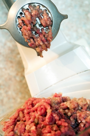 Meat grinder with mince meat  photo