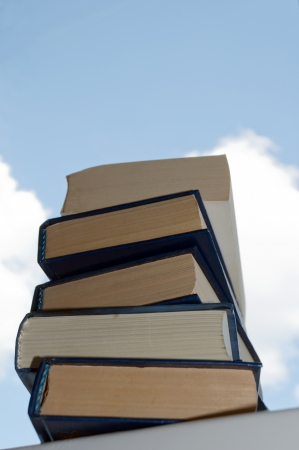 tomes: A stack of books on the windowsill