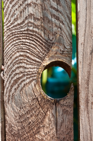 a hole in a old wooden fence   Stock Photo