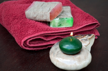 Spa setting with natural soaps and candles
