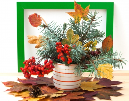 autumn bouquet (dry leaves, branches, cones and berries) photo