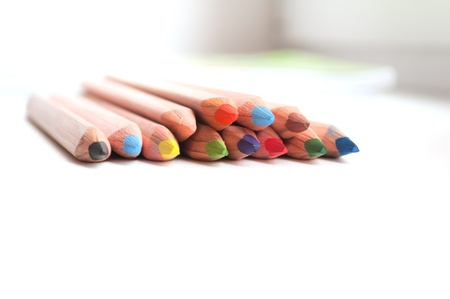 window sill: colored pencils on a window sill Stock Photo