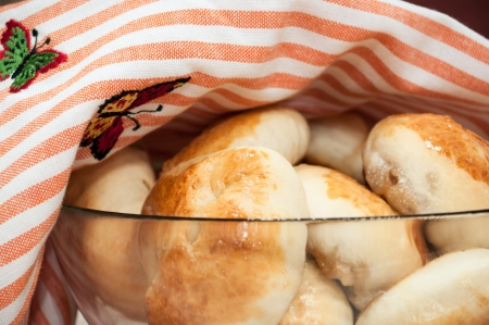 Big plate of russian pirogi covered with a towel Stock Photo