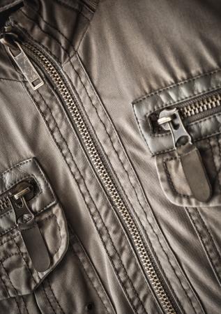hem:  toned jacket fragment with metal zipper