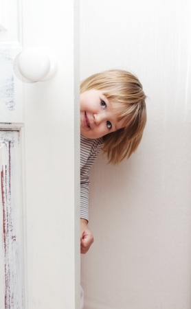Little girl having fun playing at home Stock Photo