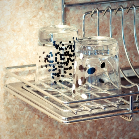 Dish rack on kitchen countertop  Clean glass photo