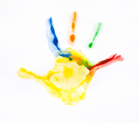 Colorful handprints  Imprint child hands painted in different colors photo