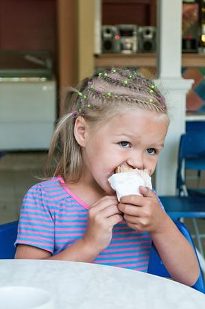Girl eating ice Cream Stock Photo - 25903396