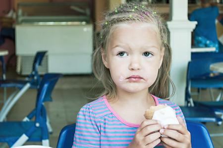 Little girl eating ice cream  Stock Photo - 26625452