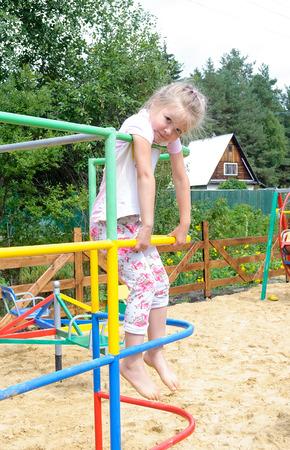 Active little girl on playground  photo