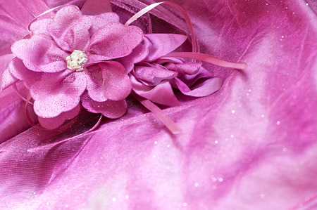 artifical: Artifical fabric flower and beads on pink background Stock Photo