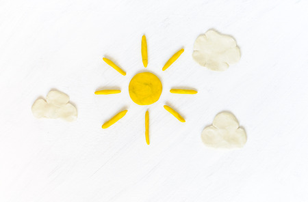 modeling clay: Sun and clouds on sky made from modeling clay Stock Photo