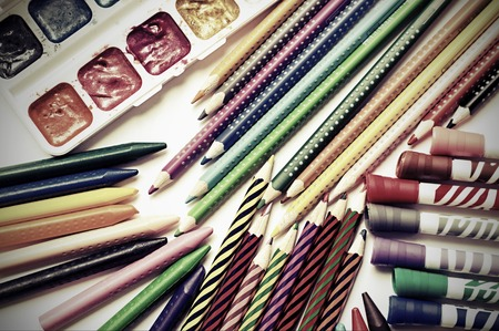 colored pencils: Colored pencils, crayons, markers and paints on white background Stock Photo