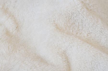 soft tissue: Blurred background of soft tissue. Beige background of plush fabric