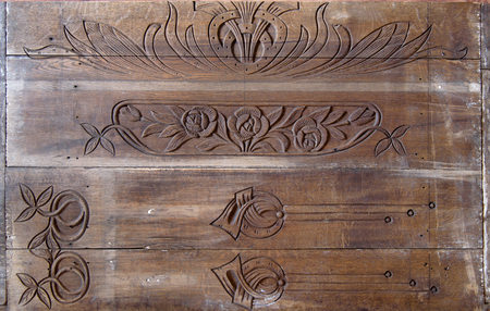 Details of a fine wood carving art. Old wooden desk.