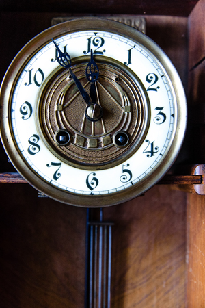 Fragment of antique wall clock with pendulum Stock Photo
