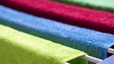dryer: Multi-colored terry towels hang on the dryer. Close-up, shallow depth of field