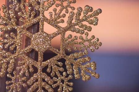 backgroundbackground with close up shot christmas decoration snowflake . Holiday decor concept. Toned photo