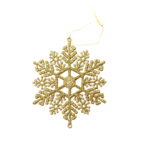 Close up christmas decoration golden snowflake isolated on white background. Holiday decor concept. Overhead.
