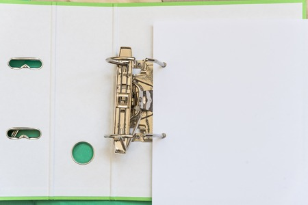 Open folder with metal clip for papers. Office tools. View from above with copy space