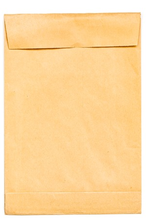 Blank envelope from kraft paper on a white background. The concept of mail, letters, messages. A clean, blank page in the ruler. 免版税图像