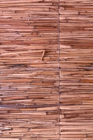 detail of Japanese thatched roof texture background. straw wall. Hay or dry grass background. Thatch roof for background, dried straw or cane. Stockfoto