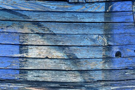 Old Paint Blue And Yellow Color On A Dirty Wooden Surface. Old Cracked Painted Wood Stock fotó