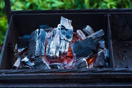 Burning coal. Hot burning and glowing coal. Kindle coal for barbecue in the garden.
