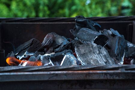 Burning coal. Hot burning and glowing coal. Kindle coal for barbecue in the garden. Stock Photo