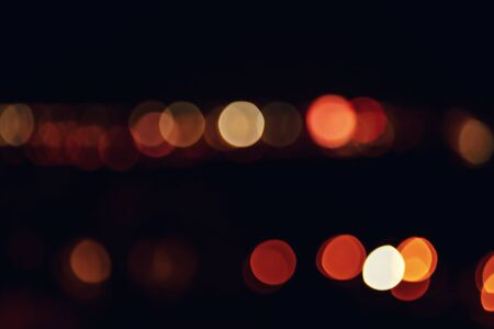 Night lights abstract, city traffic. Blurred image of Cityscape with beautiful bokeh, at night time, for background