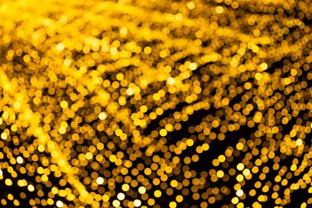 Abstract bokeh from Lighting decor for background.  Gold Dust Over Black